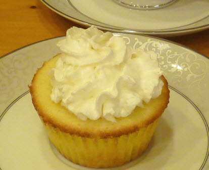 Lemon cupcake with whipped cream